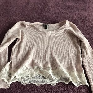 Light pink sweater with lace at the bottom